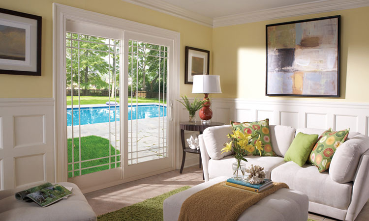 patio doors leading from a living room to a pool